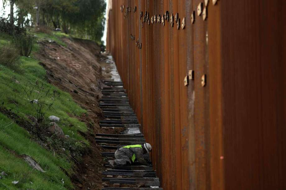 "There is already some 350 miles of barrier at the U.S.-Mexico border, much like this one separating the San Diego area from Tijuana. Trump wants $5.7 billion to add 150 miles more along the 2,000-mile border. If this is ""immoral,"" what of the existing barriers? Photo: GUILLERMO ARIAS /AFP /Getty Images / AFP or licensors"