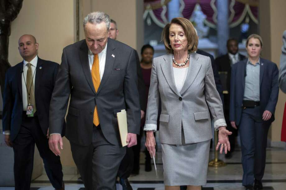Speaker of the House Nancy Pelosi, Senate Minority Leader Chuck Schumer, D-N.Y., and other lawmakers' prioritiy must be to fund the government — without wasting money on a boondoggle. Photo: J. Scott Applewhite /Associated Press / Copyright 2019 The Associated Press. All rights reserved.