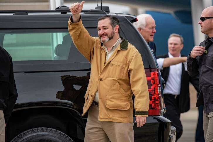 "Senator Ted Cruz, a Republican from Texas, gestures while arriving at McAllen-Miller International Airport in McAllen, Texas, U.S., on Thursday, Jan. 10, 2019. President Donald Trump's decision to bid ""bye bye"" to House Speaker Nancy Pelosi and storm out of a White House meeting brought relations between the president and Democrats to a new low just as the impact of the nearly three-week government shutdown was set to intensify. Photographer: Sergio Flores/Bloomberg"