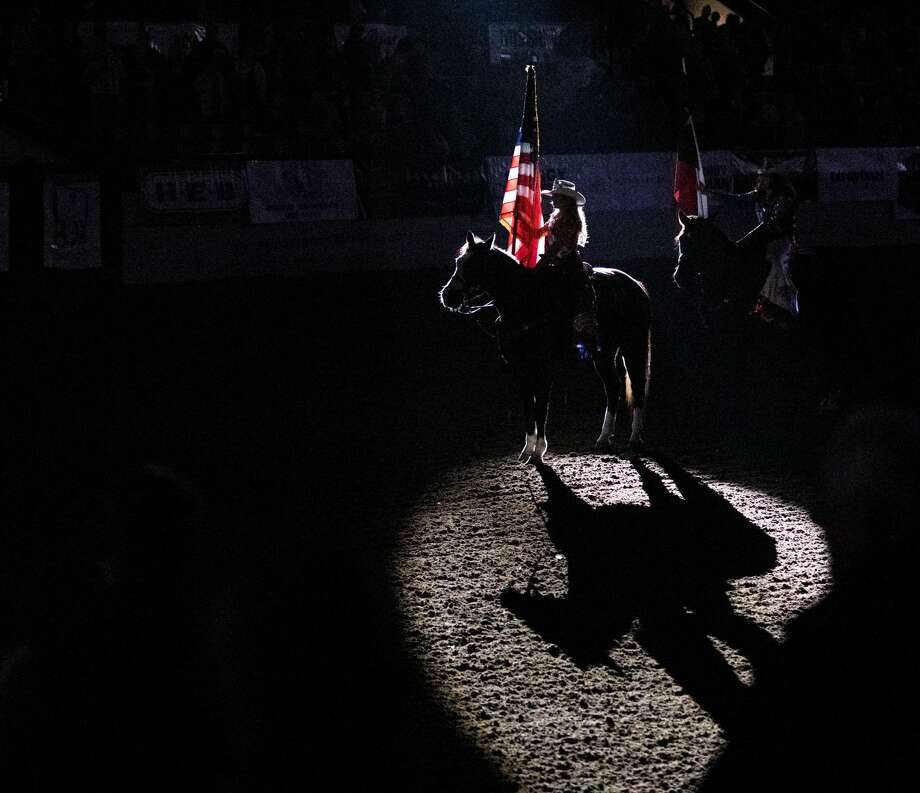 Jordan Maldonado presents the flag of the United States during the National Anthem on Thursday night during the Sandhills Rodeo at the Ector County Coliseum. Photo: Jacy Lewis/191 News