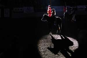 Jordan Maldonado presents the flag of the United States during the National Anthem on Thursday night during the Sandhills Rodeo at the Ector County Coliseum.