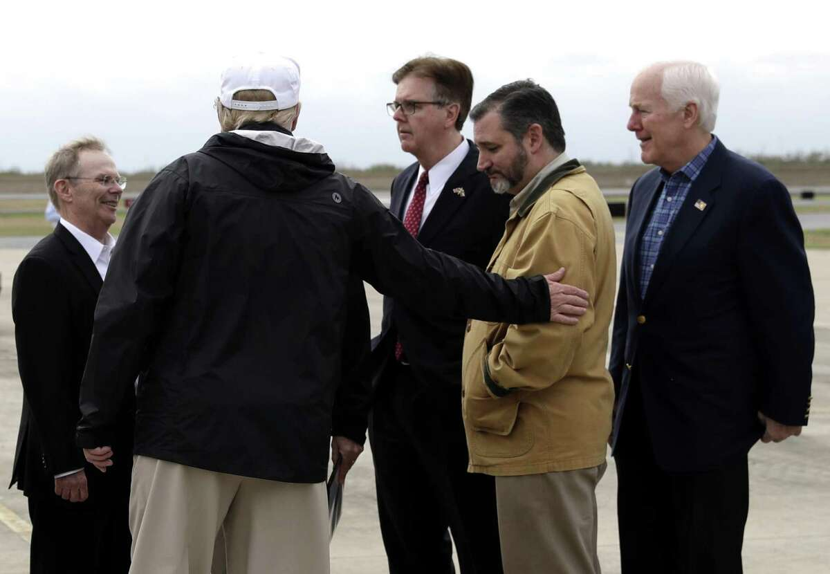 President Donald Trump gestures to Sen. Ted Cruz, R-Texas, as Sen. John Cornyn, R-Texas, and others watch, after Trump arrived at McAllen International Airport for a visit to the southern border, Thursday, Jan. 10, 2019, in McAllen, Texas. (AP Photo/ Evan Vucci)