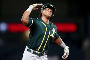 ARLINGTON, TX - JULY 24:  Khris Davis #2 of the Oakland Athletics celebrates after hitting a three-run home run in the top of the tenth inning to beat the Texas Rangers at Globe Life Park in Arlington on July 24, 2018 in Arlington, Texas.  (Photo by Tom Pennington/Getty Images)