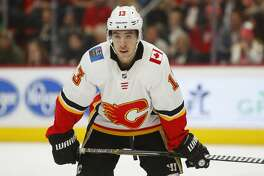 Calgary Flames left wing Johnny Gaudreau plays against the Detroit Red Wings in the third period of an NHL hockey game Wednesday, Jan. 2, 2019, in Detroit. (AP Photo/Paul Sancya)