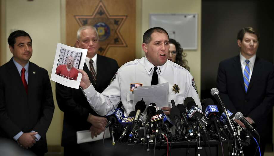 Barron County Sheriff Chris Fitzgerald holds up the booking photo of Jake Thomas Patterson, who allegedly kidnapped Jayme Closs, during a news conference, Friday, Jan. 11, 2018, in Barron, Wis. Closs, a 13-year-old northwestern Wisconsin girl who went missing in October after her parents were killed, was found alive in the rural town of Gordon, Wis., about about 60 miles north of her home in Barron. Investigators believe Patterson, who was taken into custody shortly after Closs was found, killed her parents because he wanted to abduct her. (Jean Pieri/Pioneer Press via AP) Photo: Jean Pieri / Associated Press