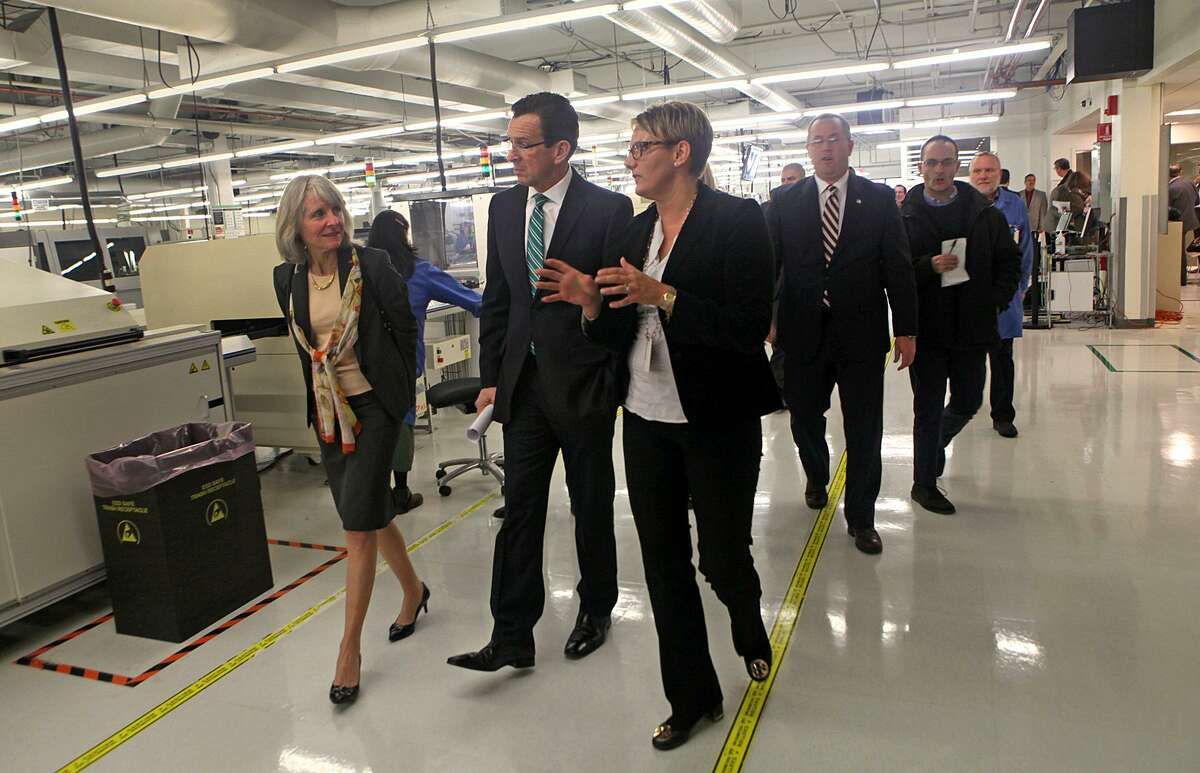 Former Connecticut Gov. Dannel P. Malloy on a 2014 tour of Microboard Processing in Seymour, among some 1,900 companies to receive state financing under Malloy's Small Business Express program.