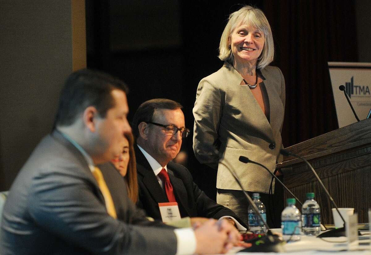 Catherine Smith, leads an economic panel discussion in November 2015 at Fairfield University, in her role as commissioner of the Connecticut Department of Economic and Community Development.