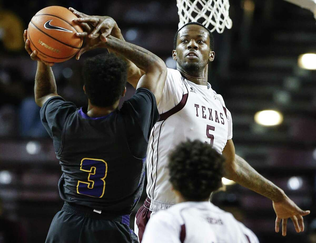 Texas Southern center Trayvon Reed (5) blocks a shot by Prairie View A&M guard Gary Blackston (3) during the first half of an NCAA basketball game at TSU's HPE Arena on Saturday, Jan. 6, 2018, in Houston. ( Brett Coomer / Houston Chronicle )