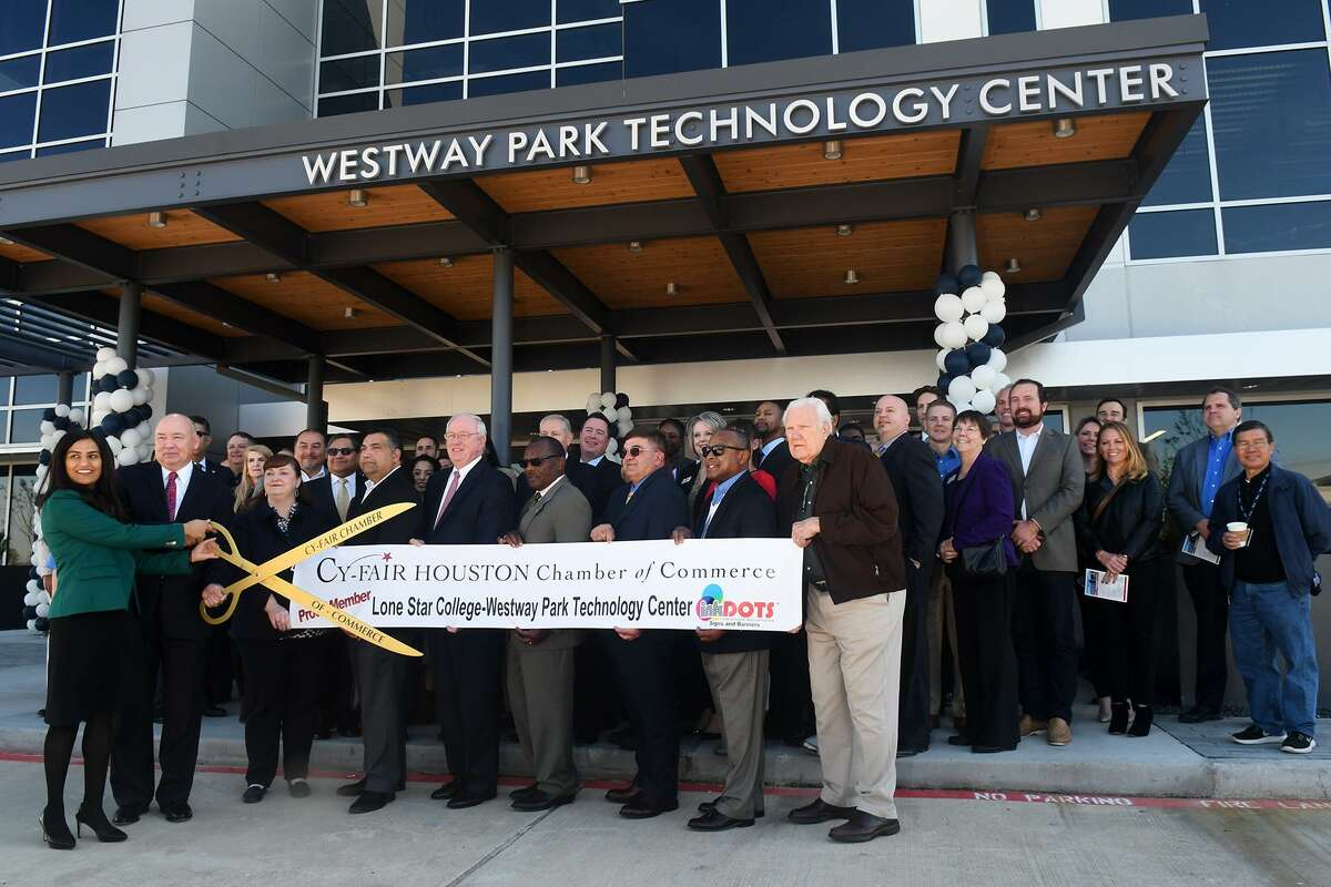 Seelpa Keshvala, left, Ph.D., President of Lone Star College-CyFair, leads the ribbon cutting ceremony for the Lone Star College Westway Park Technology Center in Houston on Jan. 11, 2019.