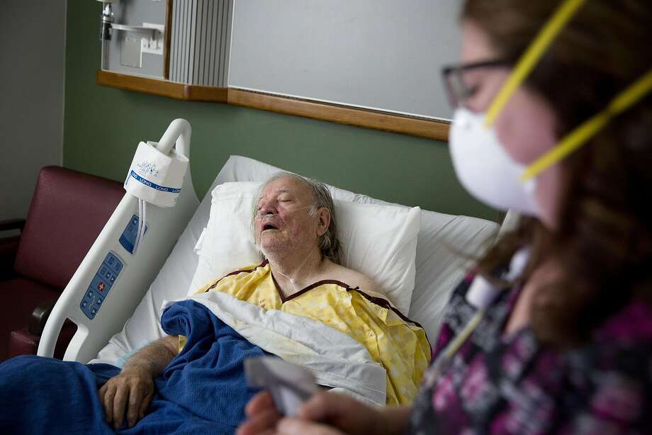 FILE - In this Friday, Feb. 9, 2018 file photo, Henry Beverly, 73, battles the flu while tended to by nurse Kathleen Burks at Upson Regional Medical Center in Thomaston, Ga. As of January 2019, the current flu season is shaping up to be gentler than last winter's unusually brutal one, health officials say. (AP Photo/David Goldman) Photo: David Goldman / Associated Press