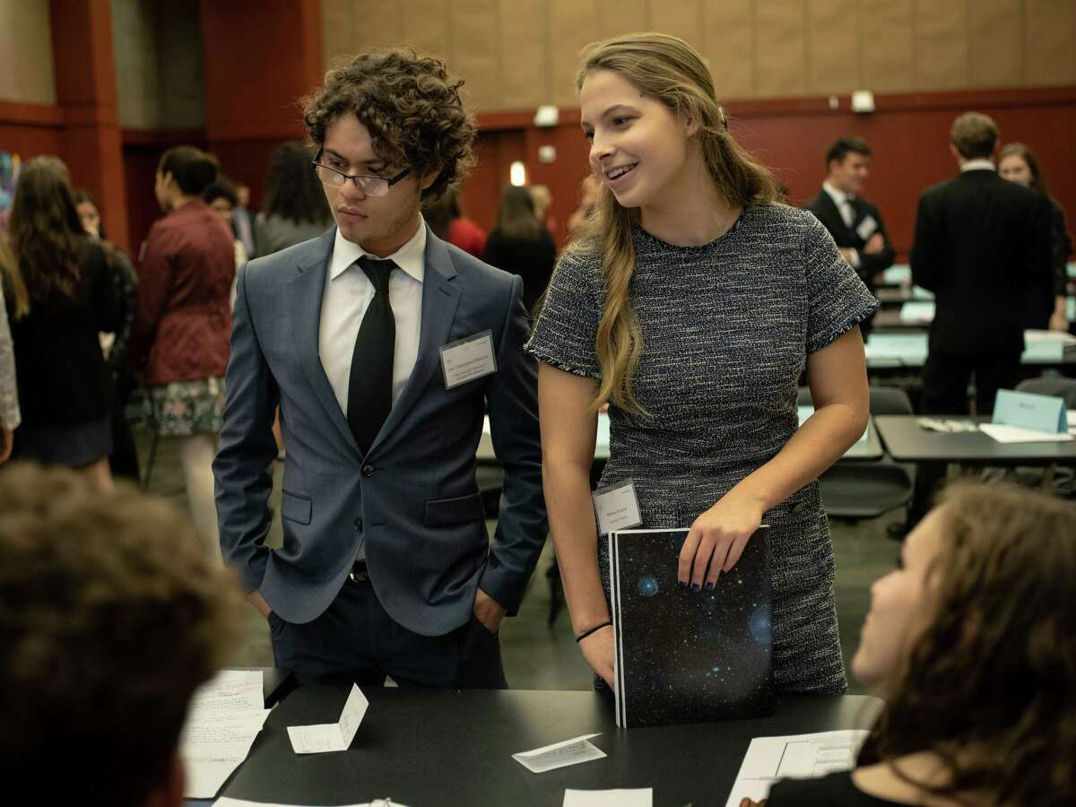 """Under Secretary General for Delegate Development Ale Talamontes-Martinez, left, and Secretary General Brooke Ramine, right, speak with the Human Rights Council during the Model United Nations San Antonio held on Trinity University's campus on Friday, Jan. 11, 2019. The conference lasted two days and included 1,200 students from 35 schools from San Antonio, Austin, Houston, Dallas and Monterey Mexico. Students who participated as delegates representing the world's countries debated topics such as """"Combating Issues Elicited by the Illegal Sex Trade,"""" and """"Limiting the Use of Armed Drones in War Zones."""""""
