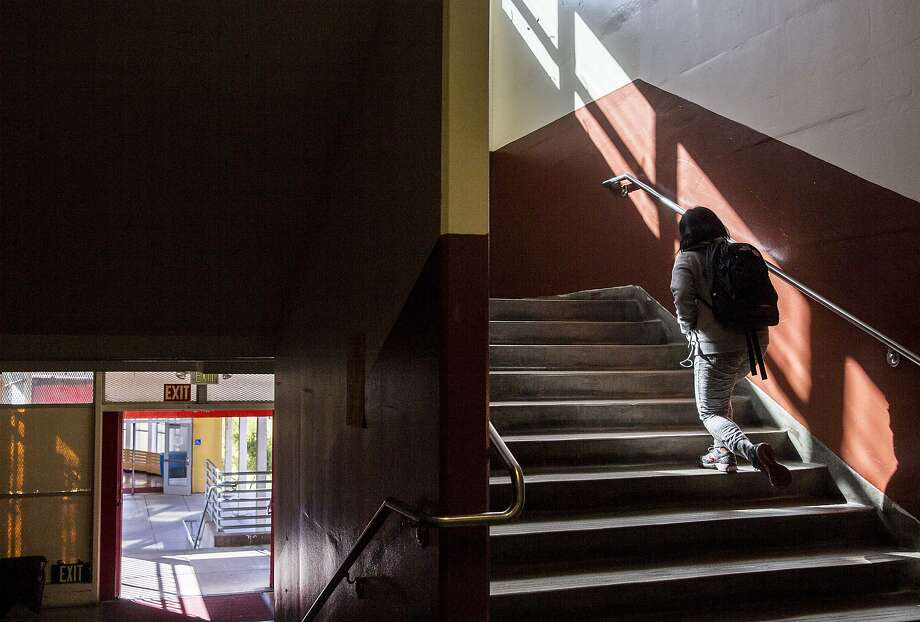 A student ascends the second floor steps on their way to class at Lowell High School in San Francisco, Calif. Friday, Sept. 21, 2018. Photo: Jessica Christian / The Chronicle 2018