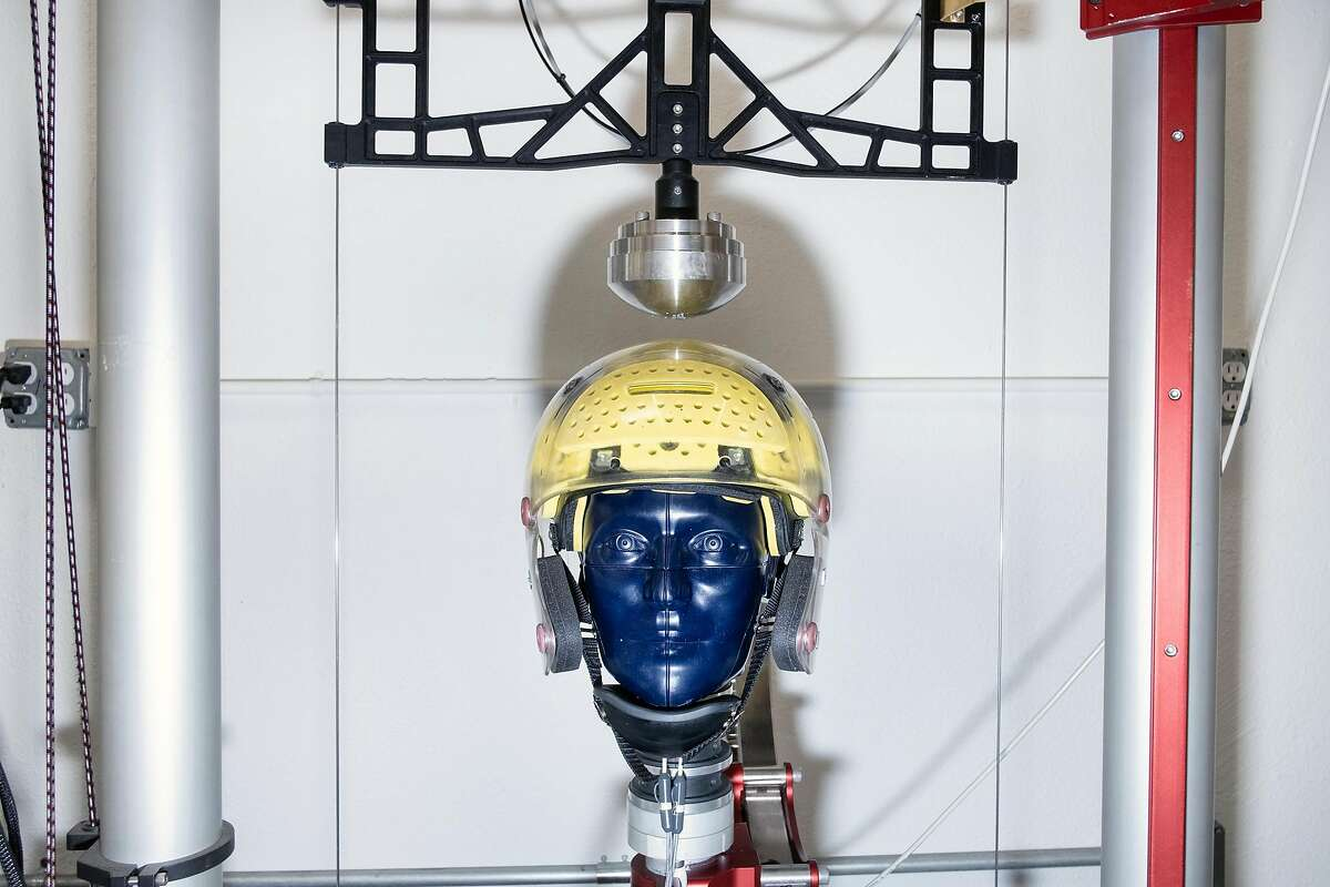 A prototype football helmet is strapped to a test dummy's head on an impact testing drop rig at Brainguard Technologies Inc. facilities in Richmond, California, on Thursday, December 13, 2018. A group of UC Berkeley faculty and alums has launched the start-up Brainguard Technologies Inc. addressing the key issue in CTE: rotational force, and are developing helmets for all major sports that tackle the issue.