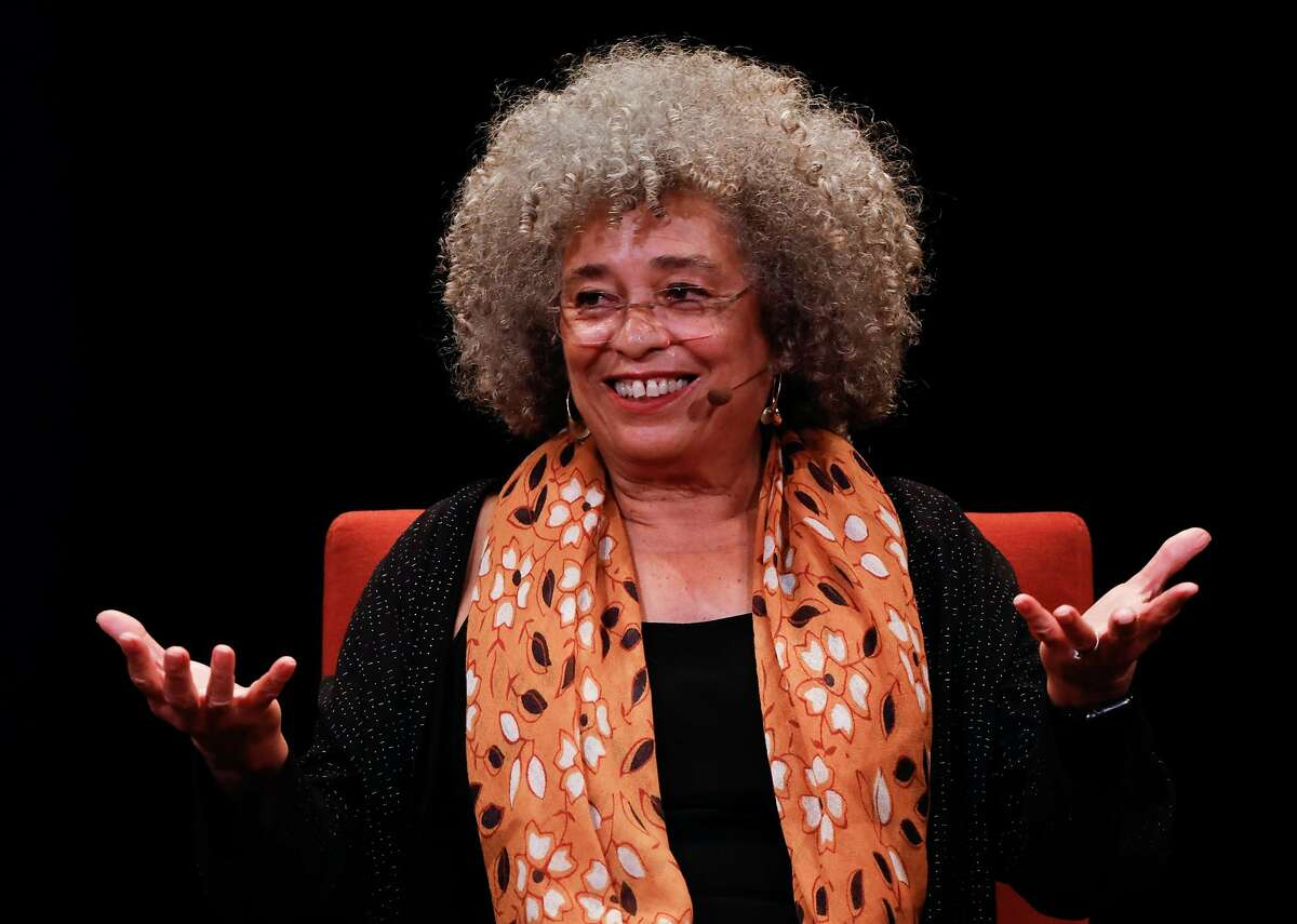 Activist Angela Davis (center) speaks during a panel discussion at City Arts & Lectures in San Francisco, California, on Thursday, Jan. 10, 2019.