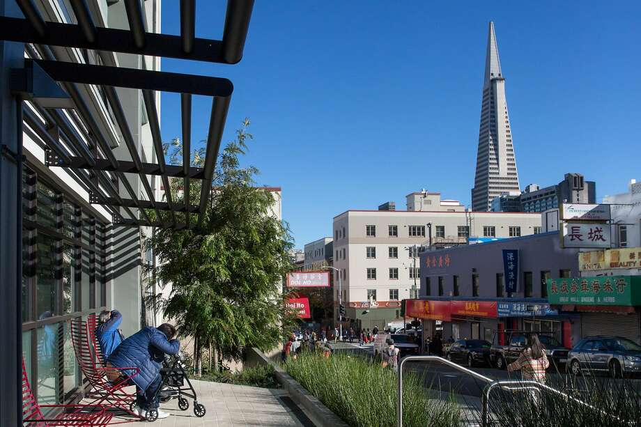 The outdoor seating area at Ping Yuen North overlooks Chinatown as the Transamerica Pyramid towers several blocks away. Photo: Jana Asenbrennerova / Special To The Chronicle