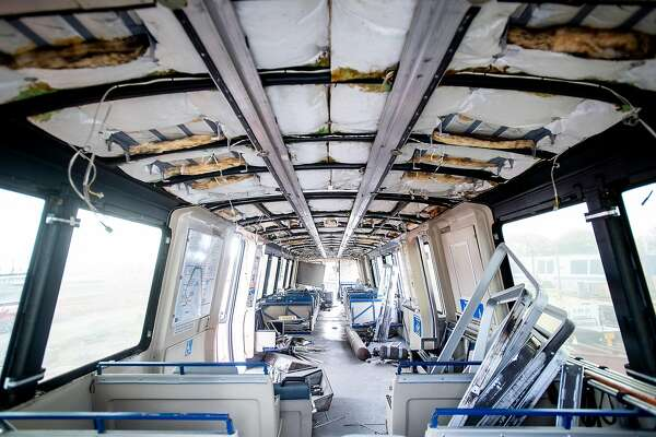 Rubble lines the interior of BART car 2528, slated to be the first decommissioned as new trains enter the transit system's fleet, at BART's Hayward, Calif., maintenance yard on Wednesday, Jan. 9, 2019.