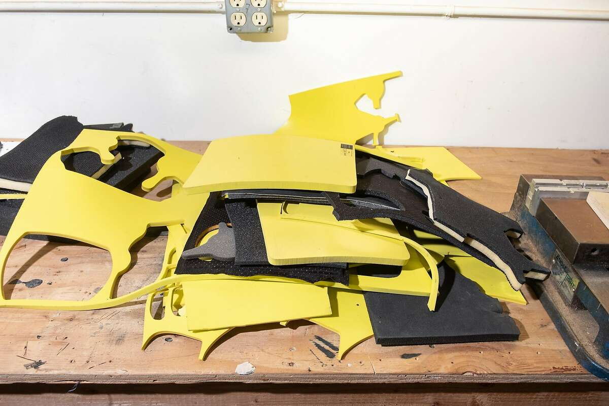 Pieces of XRD Foam, which is used in sports helmets, are scattered on a work bench at Brainguard Technologies Inc. facilities in Richmond, California, on Thursday, December 13, 2018. A group of UC Berkeley faculty and alums has launched the start-up Brainguard Technologies Inc. addressing the key issue in CTE: rotational force, and are developing helmets for all major sports that tackle the issue.
