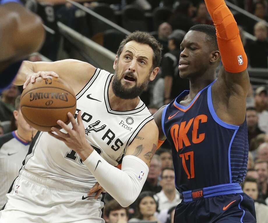 Marco Belinelli slips by Dennis Schroder as the Spurs host Oklahoma at the AT&T Center on January 10, 2019. Photo: Tom Reel, Staff Photographer