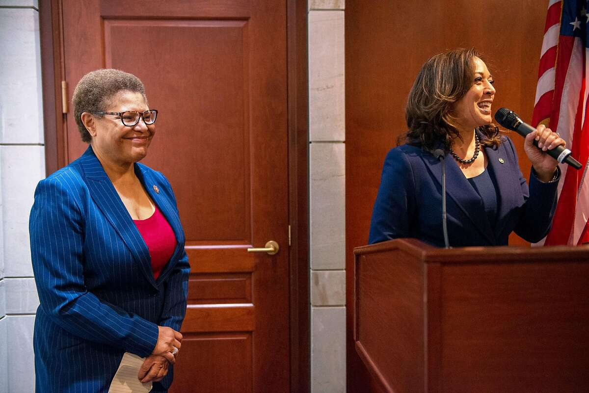 WASHINGTON, D.C. - JANUARY 9, 2019: Chairman of the Congressional Black Caucus, Rep. Karen Bass, D-Calif. (left), listens as Sen. Kamala Harris (right), D-Calif., speaks at the Capital Visitors Center in Northwest Washington, D.C., during an event welcoming the incoming women members of the Congressional Black Caucus on January 9, 2019. CREDIT: Photo by Andrew Mangum for The San Francisco Chronicle