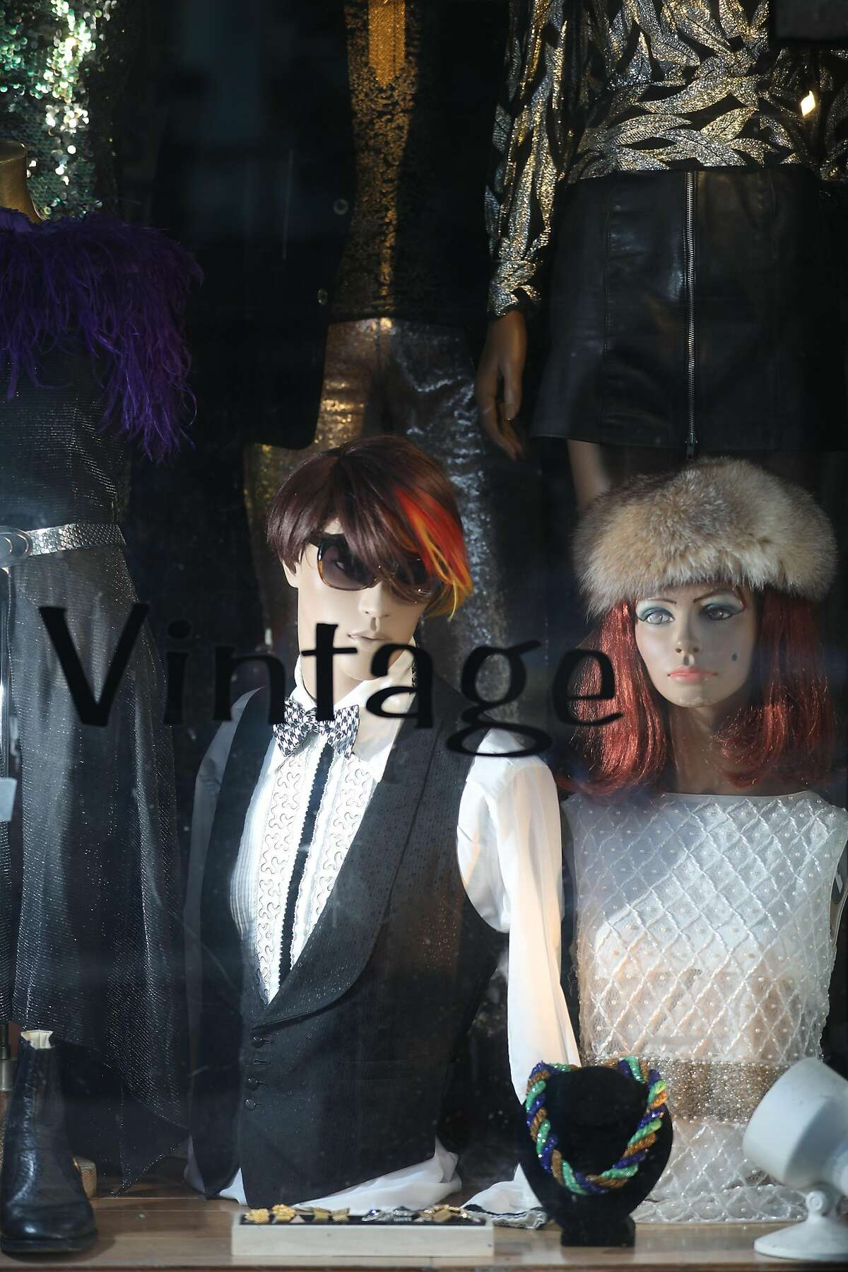 Mannequin's wearing vintage fashion are seen in the storefront of Schauplatz vintage on Thursday, January 10, 2019 in San Francisco, Calif.