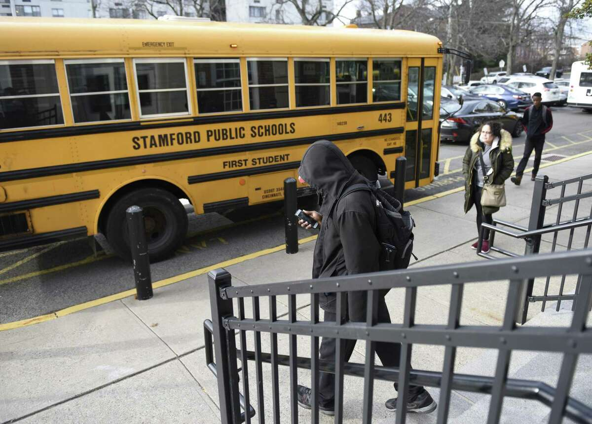 Students leave school after the closing bell at Stamford High School in Stamford, Conn. Thursday, Jan. 10, 2019. This fall, Stamford High will be implementing a new schedule where students will have eight classes in 85-minute periods with a rotating schedule with four blocks a day. The change will help the school comply to new state graduation requirements.