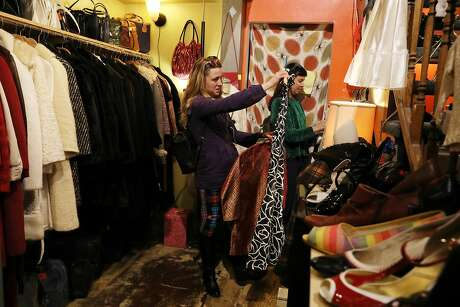 Destini Cox (l to r) of San Francisco checks out a dress at Schauplatz Vintage store as Nicki Scutti of San Francisco peruses the racks on Valencia Street on Thursday, January 10,  2019  in San Francisco, Calif.