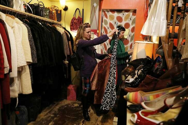 Destini Cox (l to r) of San Francisco checks out a dress at Schauplatz Vintage store as Nicki Scutti of San Francisco peruses the racks on Valencia Street on Thursday, January 10,  2019  in San Francisco, Calif.