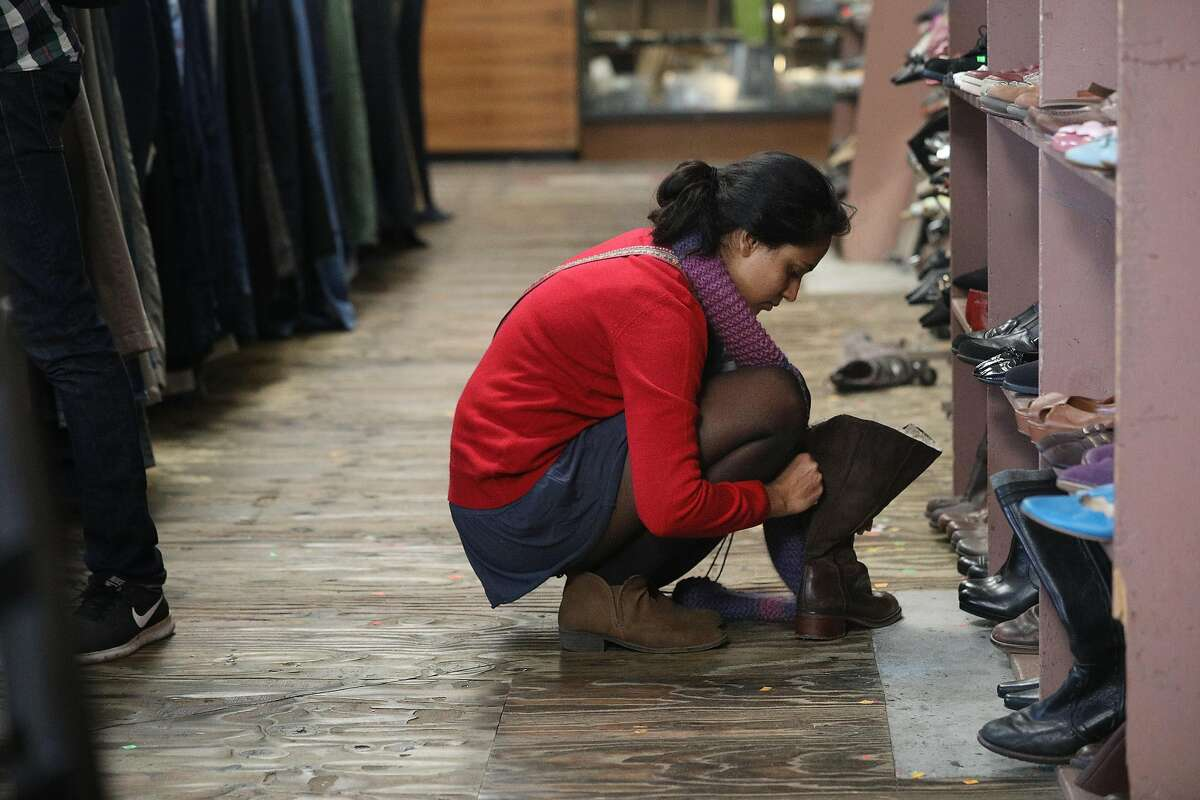 Purnima Kumar of Berlin looks over some different shoes at Community Thrift on Valencia Street on Thursday, January 10, 2019 in San Francisco, Calif.