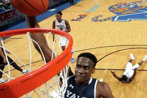 Yale's Miye Oni dunks the ball against Memphis on Nov. 17 at FedEx Forum in Memphis, Tennessee.