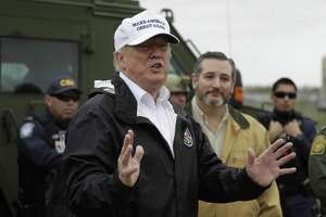 President Donald Trump speaks as he tours the U.S. border with Mexico at the Rio Grande on the southern border, Thursday, Jan. 10, 2019, in McAllen, Texas, as Sen. Ted Cruz, R-Texas, listens at right. (AP Photo/ Evan Vucci)