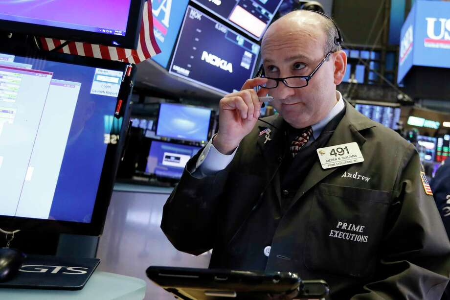 Trader Andrew Silverman works on the floor of the New York Stock Exchange, Friday, Jan. 11, 2019. Stocks are opening broadly lower on Wall Street, led by declines in banks and technology companies. (AP Photo/Richard Drew) Photo: Richard Drew / Copyright 2018 The Associated Press. All rights reserved