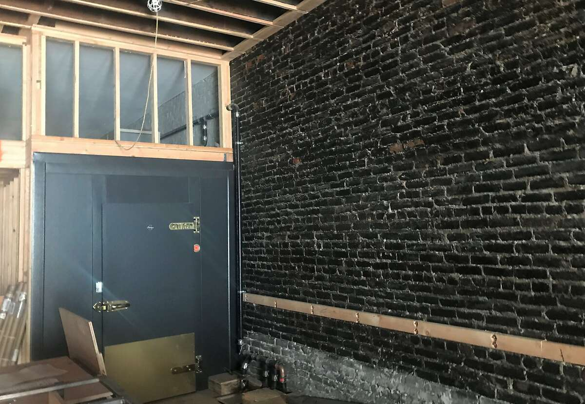 The brick wall in Sam's Tavern as it looked in July of 2018, after being cleaned but before construction of the tavern began in earnest. The black on the masonry is soot left behind from the 1906 earthquake and fire, according to the bar's owners.