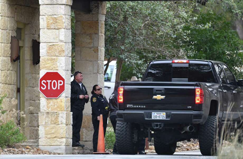 Security officers and Bexar County sheriff's officials check vehicles going into the gated Anaqua Springs Ranch community near Leon Springs after three people were found shot to death in an upscale home there Thursday. Photo: Billy Calzada /Staff Photographer / San Antonio Express-News
