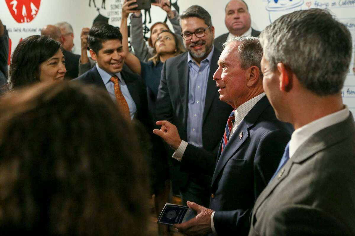 United Nations Special Envoy for Climate Action and former New York City Mayor Michael Bloomberg, second from right, meets members of the San Antonio City Council after a news conference Jan. 11 announcing up to $2.5 million to support a local climate adaptation plan.