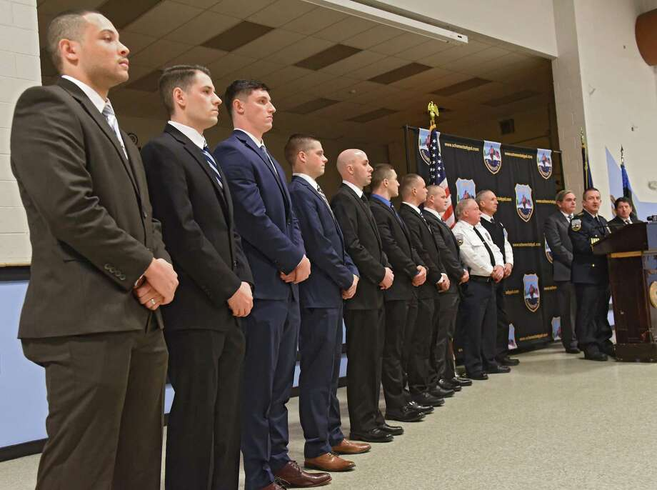 Schenectady Chief of Police Eric Clifford, right, speaks during a swearing-in ceremony for new police recruits, from left, Elijah Washington, Kevin Poltorak, Brendan Maloney, John Larkin, Raymond Klopchin, Nicholas Georgelas, Robert DeCarlo and Zachary Aviles-Presley at the Zone 5 Regional Law Enforcement Training Academy on Friday, Jan. 11, 2019 in Schenectady, N.Y. (Lori Van Buren/Times Union) Photo: Lori Van Buren / 40045904A