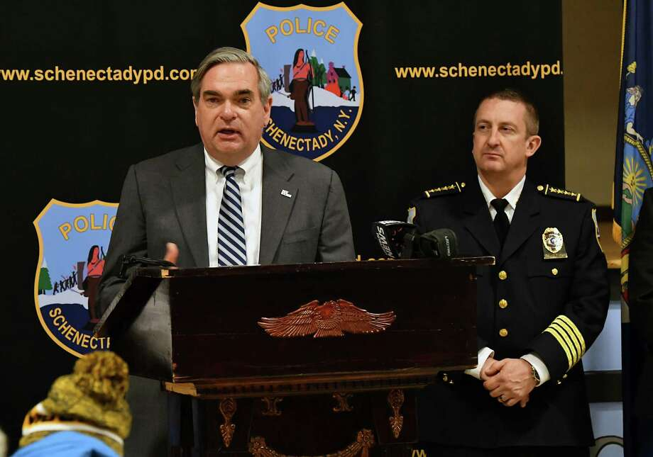 Mayor Gary McCarthy speaks during a swearing-in ceremony for new police recruits at the Zone 5 Regional Law Enforcement Training Academy on Friday, Jan. 11, 2019 in Schenectady, N.Y. Schenectady Police Chief Eric Clifford stands at right. (Lori Van Buren/Times Union) Photo: Lori Van Buren / 40045904A
