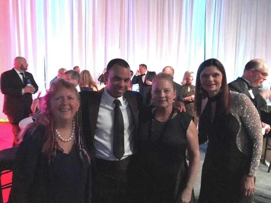 State Central Committeewoman Audrey Blondin, attorney Rob Simmelkjaer from Westport, Litchfield Selectwoman Anne C. Dranginis and Litchfield Realtor Kim D'Andrea enjoy the ball. Photo: Audrey Blondin / Contributed Photo /
