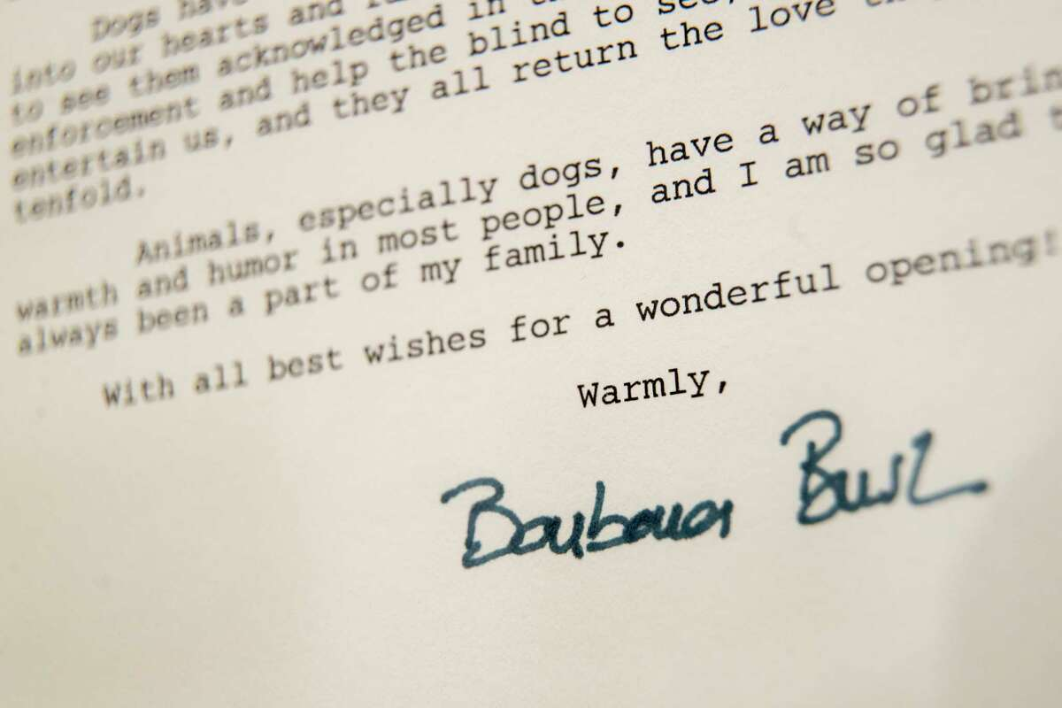 This Wednesday, Jan. 9, 2019, photo shows a detail of the letter former first lady Barbara Bush wrote to the American Kennel Club Museum of the Dog on the occasion of it's opening in 1990, on display in New York. The collection features paintings of White House dogs: U.S. President George W. Bush?s Scottish terriers, Barney and Miss Beazley, and one of President George H.W. Bush?s English springer spaniels, Millie. (AP Photo/Mary Altaffer)