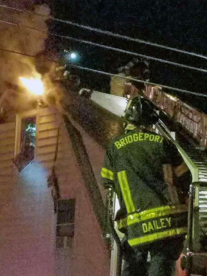 Firefighters battled an attic fire on Aldine Avenue in Bridgeport, Conn., on Jan. 11, 2019. Photo: Contributed Photo / Contributed Photo / Connecticut Post Contributed