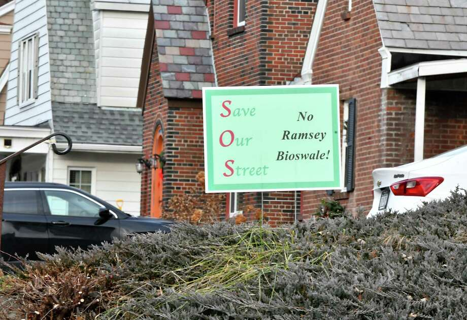 """""""Save Our Street, No Ramsey Bioswale!"""" signs are seen in front of homes along Ramsey Place on Wednesday, Dec. 5, 2018 in Albany, N.Y. (Lori Van Buren/Times Union) Photo: Lori Van Buren / 20045646A"""