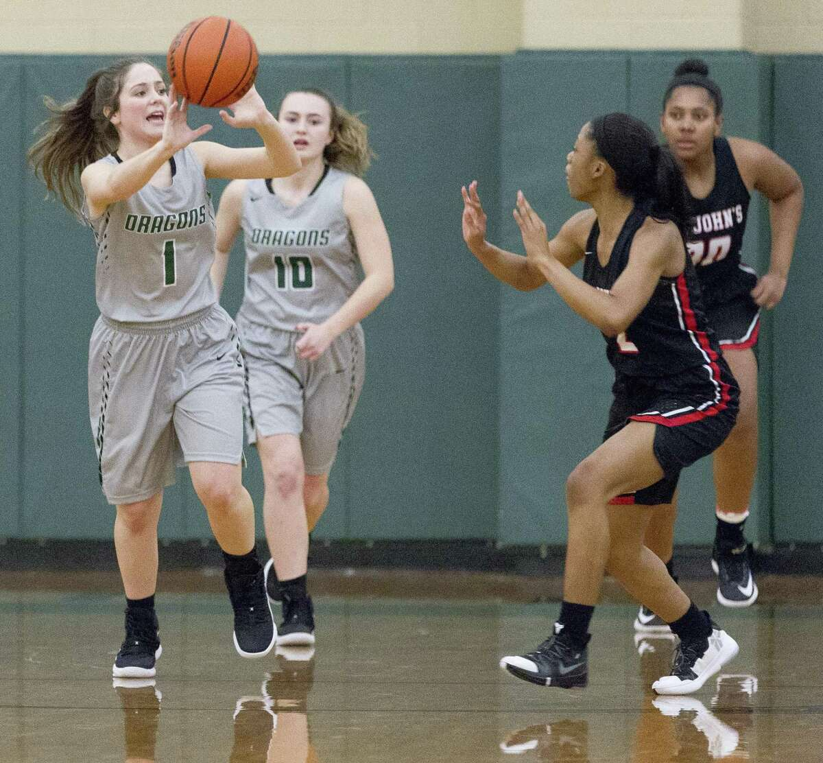 John Cooper guard Abby Monsanto (1) makes a pass during the first quarter of a Southwest Preparatory Conference high school basketball game at The John Cooper School, Friday, Jan. 11, 2019, in The Woodlands.
