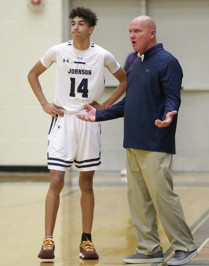 Jaguar coach Jay Leller explains a court situation to Jaren Randle as Johnson plays Roosevelt in boys basketball at Littleton Gym on January 11, 2019. Photo: Tom Reel, Staff / Staff Photographer / 2018 SAN ANTONIO EXPRESS-NEWS
