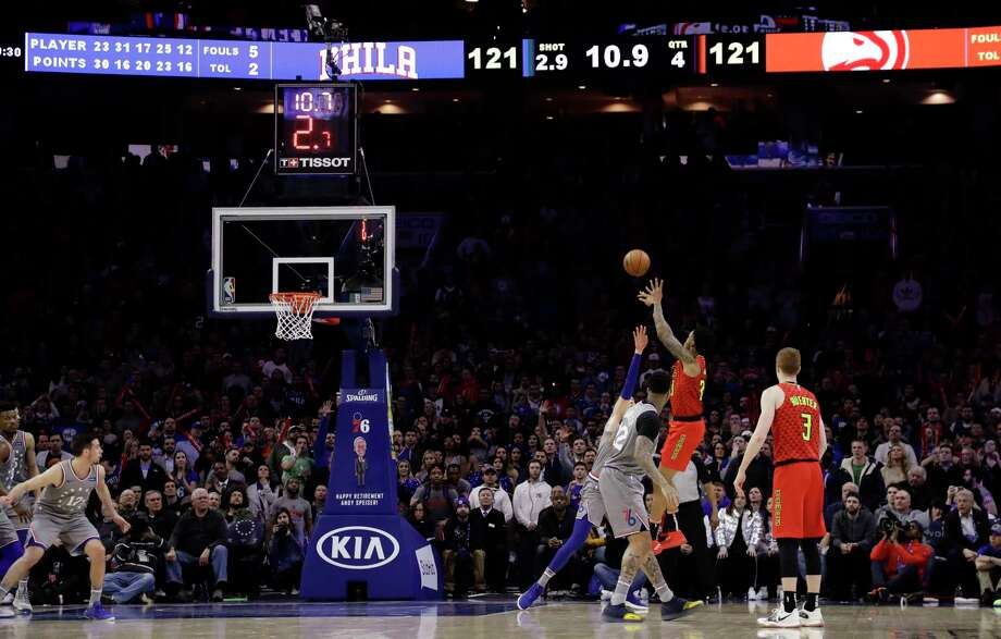 Atlanta Hawks' John Collins, second from right, shoots the go-ahead basket during the final minute of the team's NBA basketball game against the Philadelphia 76ers, Friday, Jan. 11, 2019, in Philadelphia. Atlanta won 123-121. (AP Photo/Matt Slocum) Photo: Matt Slocum / Copyright 2019 The Associated Press. All rights reserved