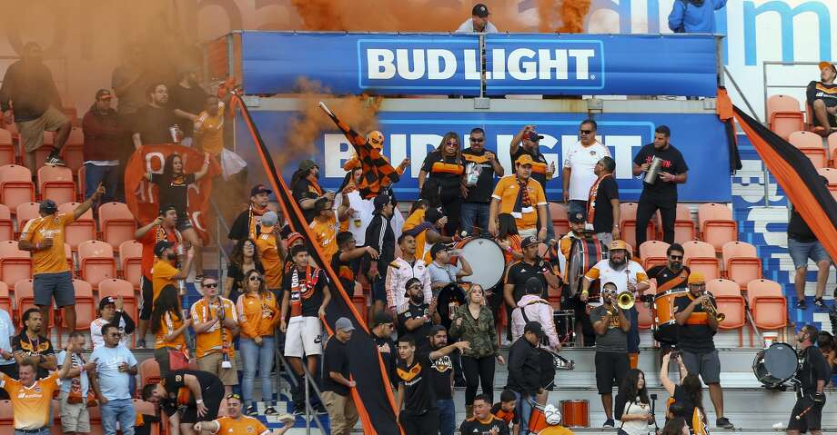 Houston Dynamo fans celebrate the team's second goal against the Seattle Sounders during the MLS match at BBVA Compass Stadium Sunday, Oct. 21, 2018, in Houston. The Sounders won 3-2. Photo: Godofredo A. Vasquez/Staff Photographer