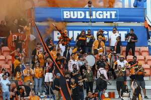 Houston Dynamo fans celebrate the team's second goal against the Seattle Sounders during the MLS match at BBVA Compass Stadium Sunday, Oct. 21, 2018, in Houston. The Sounders won 3-2.