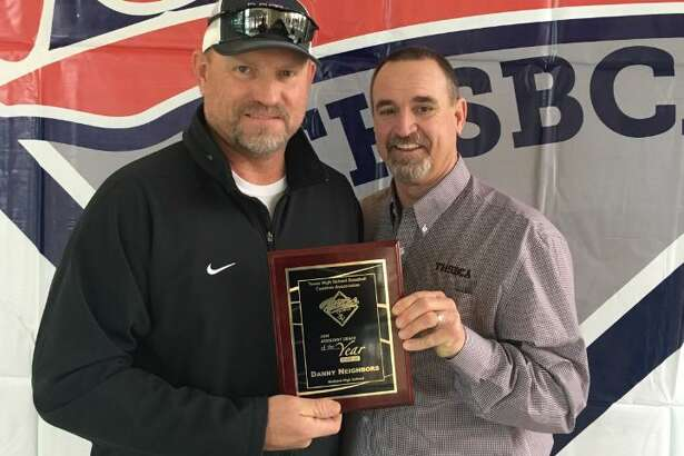 Midland High baseball assistant coach Danny Neighbors was recognized by the THSBCA as the Class 6A Assistant Coach of the Year for 2018. Neighbors, left, is shown with his award next to retired MHS baseball coach and president of the Texas High School Baseball Coaches Association Barry Russell.