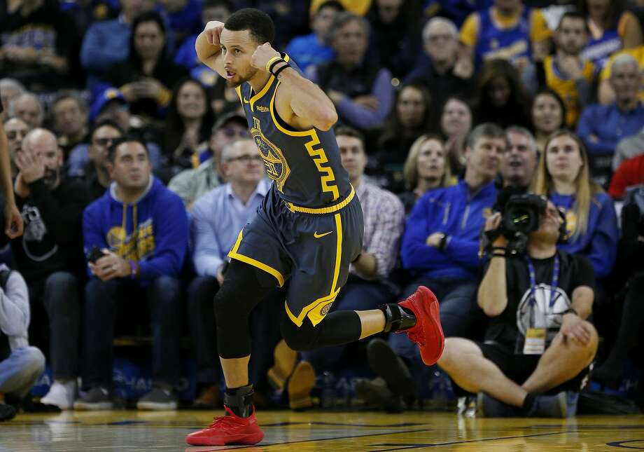The Warriors' Stephen Curry celebrates his basket against the Bulls. Curry, who had 28 points, passed Jason Terry on the all-time threes list. Only Reggie Miller and Ray Allen have more. Photo: Santiago Mejia / The Chronicle