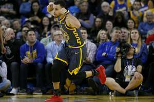 Golden State Warriors guard Stephen Curry (30) celebrates the put-back basket against the Chicago Bulls in the first half of an NBA game at Oracle Arena on Friday, Jan. 11, 2019, in Oakland, Calif.
