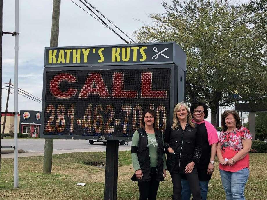 Kathy Hallmark (far right) and three of the four employees of Kathy's Kuts Photo: Elliott Lapin / Staff Photo
