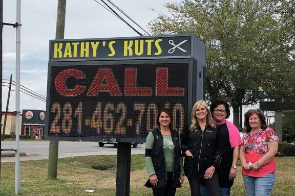 Kathy Hallmark (far right) and three of the four employees of Kathy's Kuts